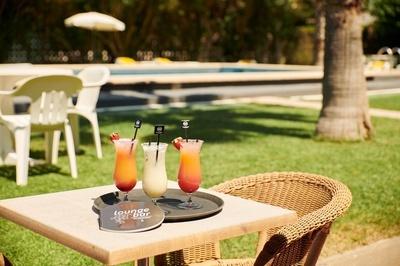 EL HOTEL - Jardín - zona piscina
